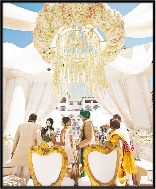 Mandap With White Drapes And Light Flowers